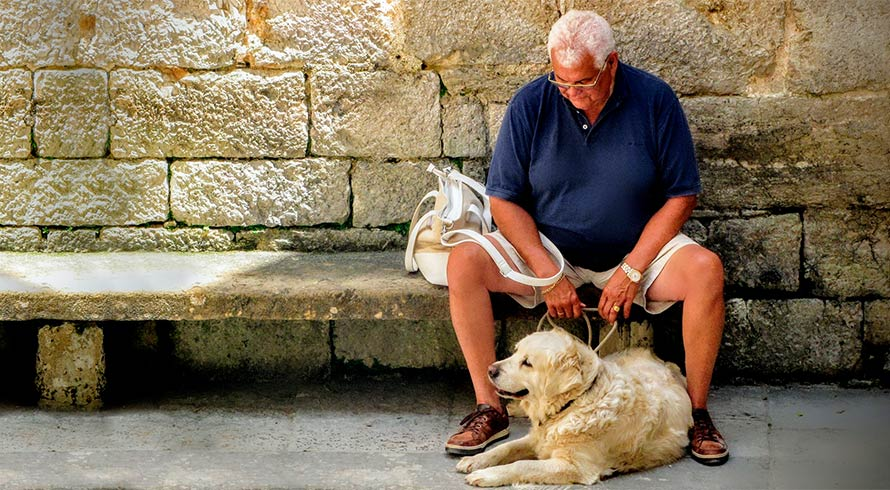 Image of mature man with dog