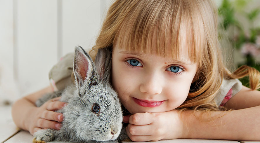 Image of child with pet rabbit